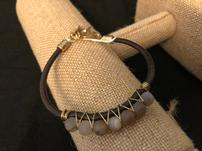 Brown leather and bead bracelet 202//151